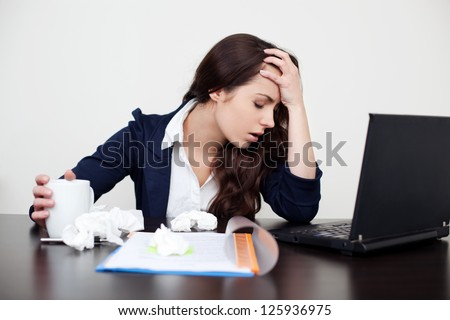 Sick woman at work with headache - stock photo