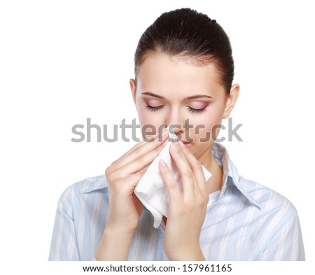 Sick woman blowing her nose, white background - stock photo