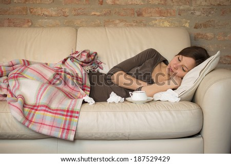 Sick Woman.Flu.Woman Caught Cold. Sneezing into Tissue. - stock photo