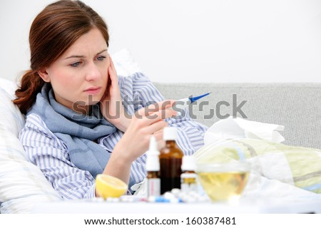 Sick woman  lying in bed with high fever. Cold, flu, fever and migraine - stock photo