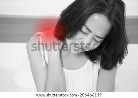 sick woman on bed concept of back pain,stomachache, headache, hangover, sleeplessness or insomnia with red alert accent - stock photo