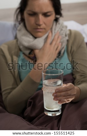 Sick woman preparing cold flu medicine to drink - stock photo