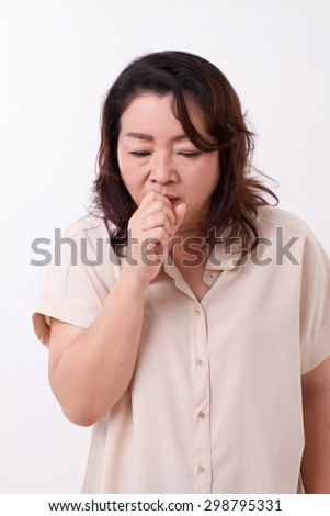 sick woman suffers from cold, flu, respiratory issue - stock photo