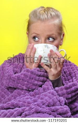 Sick woman with a flu drinking hot tea. - stock photo
