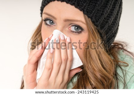 sick woman with a handkerchief / sick woman - stock photo