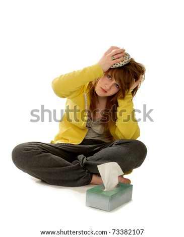 Sick woman with ice on her headache - stock photo