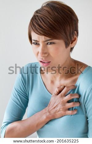 sick woman with sudden heart attack symptom - stock photo