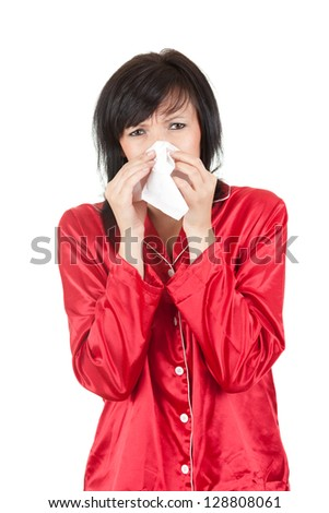sick woman with tissue blowing her nose, white background - stock photo