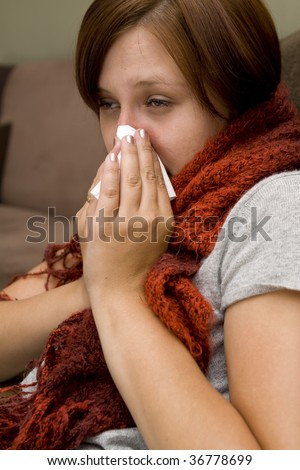 Sick women with a lot of tissues - stock photo