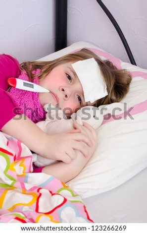 Sick young girl under temperature measurement - stock photo