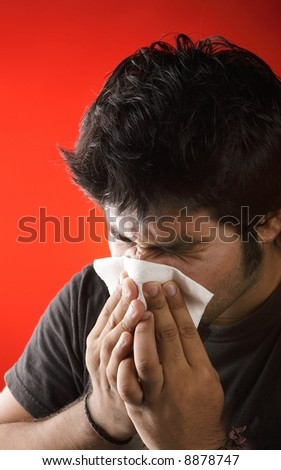 Sick young kid with the flu - stock photo