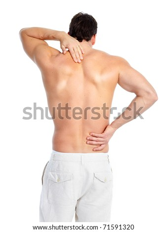 Sick young man. Back pain. Over white background - stock photo
