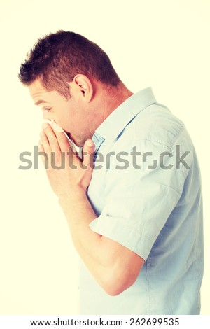 Sick young man blowing her nose - stock photo