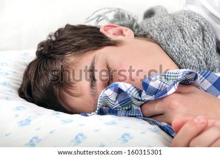 Sick Young Man sleeps with Hanky closeup - stock photo