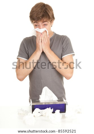 sick young man with flu blowing her nose, series - stock photo