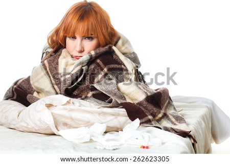 Sick young woman . red-haired girl sick in bed - stock photo