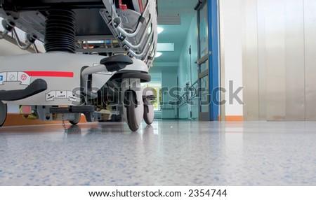 Sickbed in corridor - stock photo