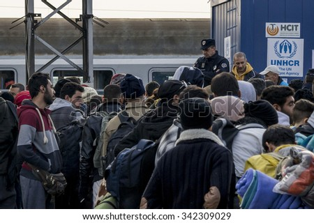 SID, SERBIA - NOVEMBER 14, 2015: Refugees waiting at Sid train station (Serbia) to board a train heading to the refugee camp of Slavonski Brod, in Croatia.