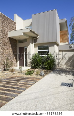 Side angle of a double storey architec designed townhouse home - stock photo