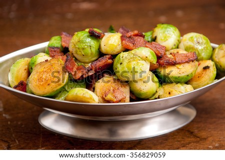 side dish of brussel sprouts with diced bacon for a holiday feast - stock photo