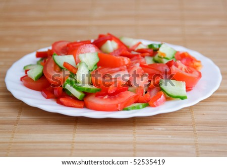 Side dish with green cucumber and red tomato