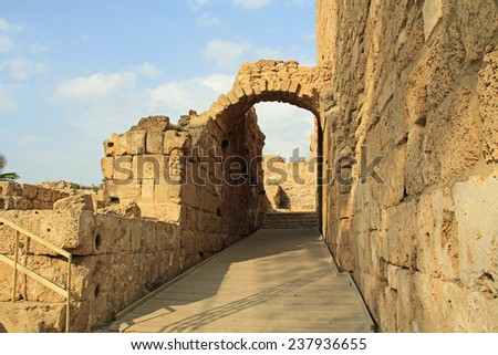 Side entrance of the Amphitheater ruins in Caesarea Maritima National Park a city and harbor built by Herod the Great about 25-13 BC. The archaeological ruins are on the Mediterranean coast of Israel.