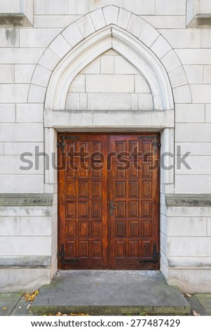 Side entrance to the historic church - stock photo