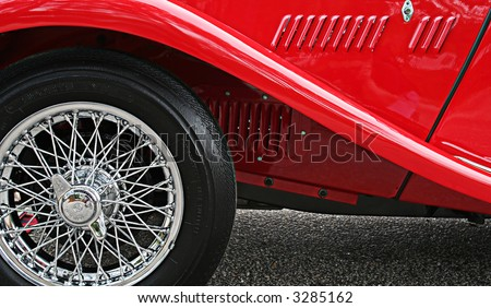 Side of a 35 Red British MG - Close up of tire, rim and fender - stock photo