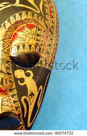 Side of African Decorative Mask With Blue Background