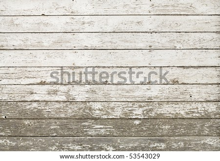 Side of an old white barn, with paint chipped and peeling. - stock photo