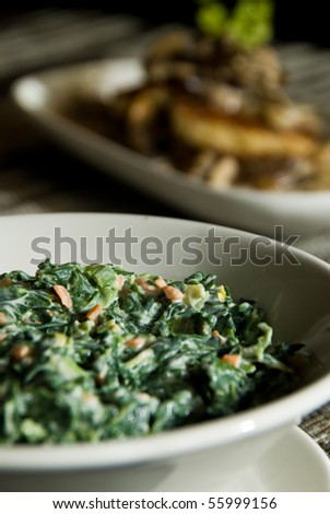 Side of mushrooms and creamed spinach - stock photo