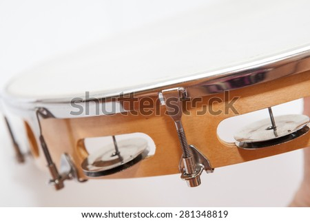 Side of tambourine with nobody holding on  a white background