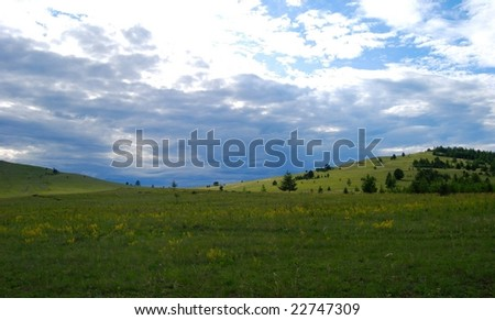 Side of the Lake Baikal, evening, getting rainy - stock photo
