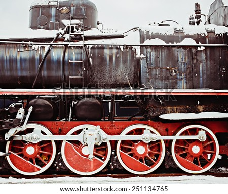 Side of the locomotive wheels with boilers - stock photo