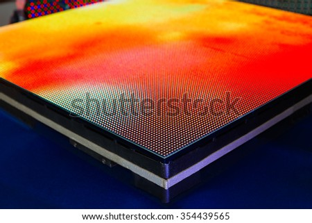 Side of the panel of LED screen with bright yellow colors - blurred background