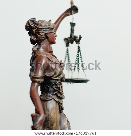 side of themis, femida or justice goddess sculpture on white - stock photo