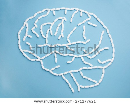 Side on view of the human brain constructed from pills - stock photo