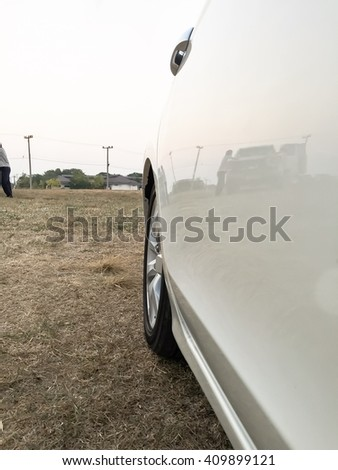 side photo of white car on field - stock photo