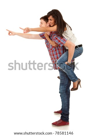 side pictureof a young man carrying his cute girl on back and pointing