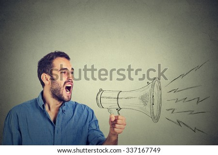 Side portrait angry young man holding screaming in megaphone isolated grey background. Negative face expression emotion feeling. Propaganda, breaking news, power, social media communication concept - stock photo