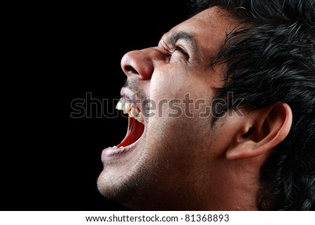 Side portrait of a screaming man