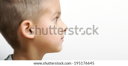 Side portrait of little boy - stock photo