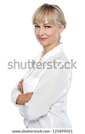 Side pose of a pretty business professional facing the camera. - stock photo