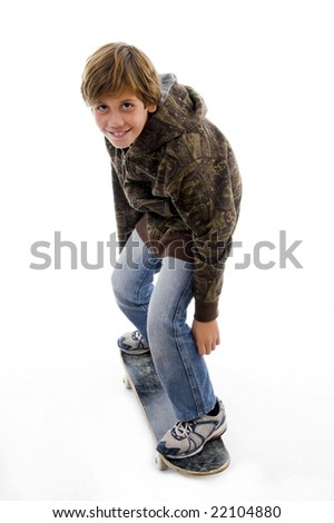 side pose of boy riding skate on an isolated background - stock photo