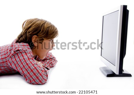 side pose of boy watching lcd screen against white background - stock photo