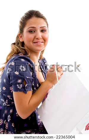 side pose of model holding shopping bags with white background - stock photo