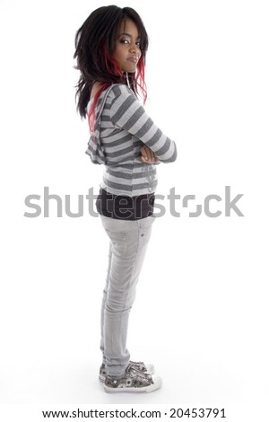 side pose of punk teenager on an isolated white background - stock photo