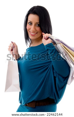 side pose of smiling model with carry bags with white background - stock photo