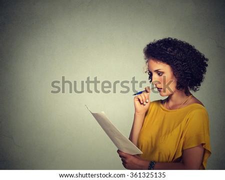 Side profile beautiful woman thinking isolated on gray background  - stock photo