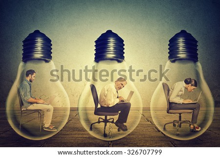 Side profile company employees sitting in row inside electric lamp using working on computer in corporate office isolated gray wall background. Generate idea concept. Working conditions productivity  - stock photo